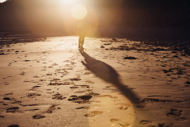 Footprints in the sand of a person walking in the distance